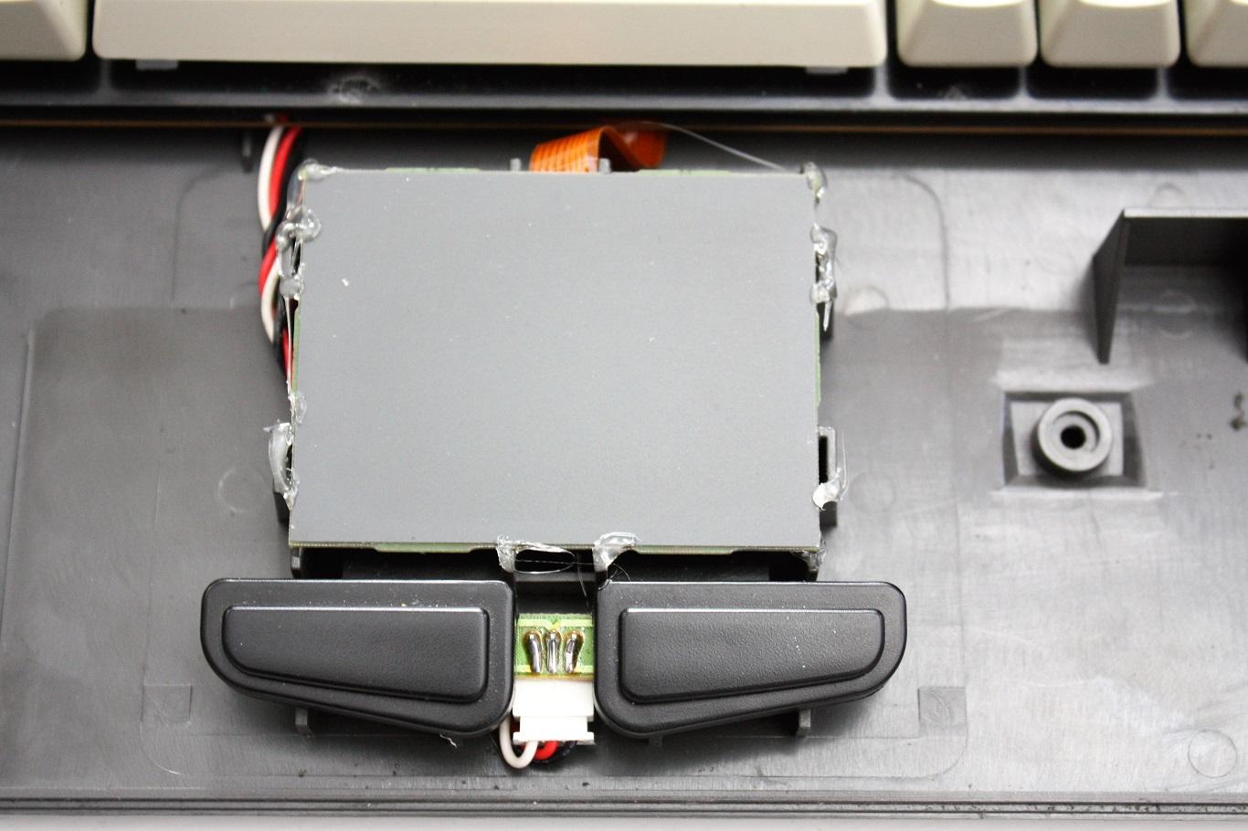 Prism N7 - integrated mouse pad.JPG