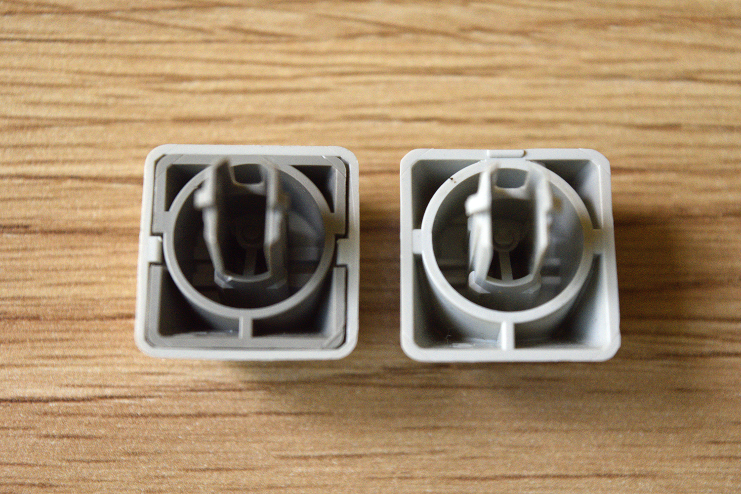 IBM 95 -- Comparison of key bottoms (Left to right): IBM Model M 1390120, IBM 95.  The sprue for the 95's keycaps is underneath the cap and not on the back.